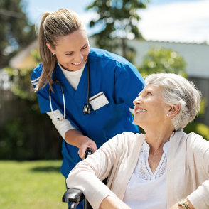 nurse and senior woman smiling at each other