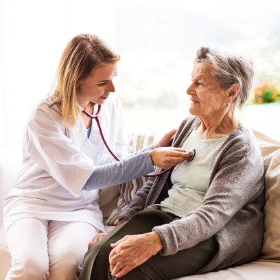 nurse checking senior's heartbeat