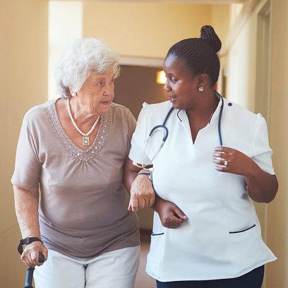 nurse guiding senior woman